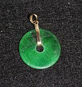 A Chinese Yellow Gold Mounted Spinach Jade Pendent