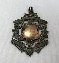 A George V Gold Mounted Sterling Silver Fob Medal