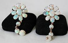 A Pair of  Rose Gold Opal Mounted Earrings