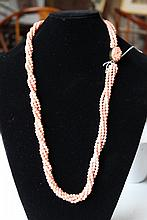 A Quadruple Strand Coral Matinee Length Necklace , c 1960
