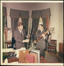 1963 PHOTOS OF KENNEDY WITH GUNS IN WHITE HOUSE (x4)