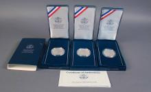 Lot Including Three US Mint Eisenhower Silver Dollars Complete in Presentation Cases