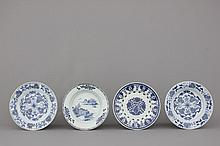 A pair and two single Chinese porcelain blue and white plates, 18th C.