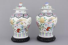 A pair of Chinese porcelain famille rose vases with floral decoration, 19th C.