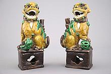 A pair of Chinese sancai glazed pottery Buddhist lion joss-stick holders, 18th C.