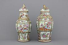 Two Chinese porcelain Canton vases and covers, 19th C.
