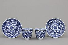 A pair of Chinese porcelain blue and white cups and saucers, Guangxu