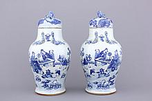 A pair of blue and white Chinese porcelain vases and covers, 19th C.
