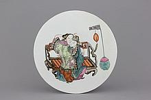 A Chinese porcelain famille rose round tile plaque with an erotical scene, 19th C.