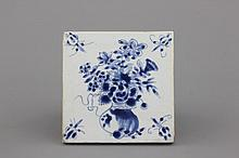 A Chinese porcelain blue and white tile with a flower vase, Ming dynasty, 16/17th C.