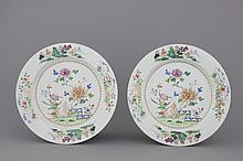 A pair of Chinese porcelain famille rose plates, 18th C.