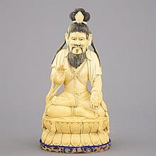 A Chinese carved ivory figure of a seated Luohan, 19/20th C.