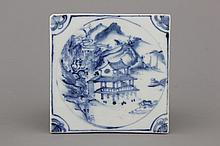 A Chinese porcelain blue and white tile with a landscape, 17/18th C.