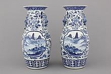 A pair of blue and white Chinese porcelain vases with landscapes, 19th C.