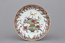 A Chinese porcelain famille rose plate with a flower basket, Yongzheng, 18th C.
