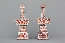 A pair of Chinese porcelain coral red decorated altar candlesticks, 19th C.