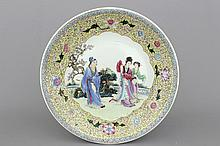 A fine large Chinese porcelain charger with figures in a garden, 20th C.