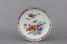 A Chinese porcelain famille rose plate, Qianlong, 18th C.