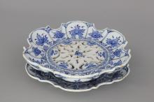 A fine Dutch Delft blue and white strawberry strainer, 18th C.
