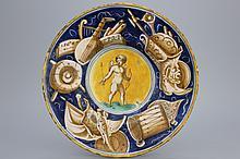 A Casteldurante maiolica plate with Cupid holding an arrow, dated 1560