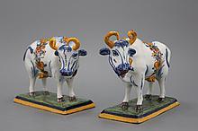 A wonderful pair of polychrome Dutch Delft cows, 18th C.