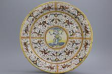 A massive Italian deruta charger with grotteschi depicting Prudence, ca. 1620