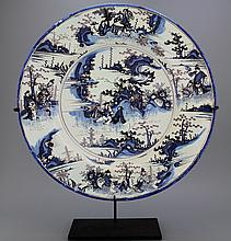 A massive French faience Nevers blue and manganese chinoiserie charger, 17th C.