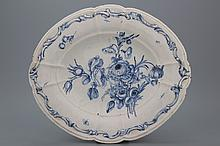 A large French faience relief molded oval blue and white dish with a very fine floral decoration, 18th C.