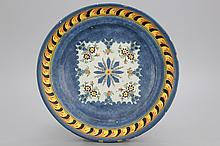 A Brussels faience blue ground plate, early 19th C.