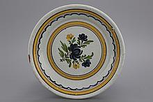 A Brussels faience floral plate, 19th C.