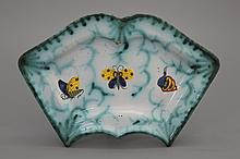 A Brussels faience butterfly-shaped condiment plate, 18th C.