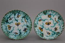 A pair of notched Brussels faience butterfly plates, 18th C.