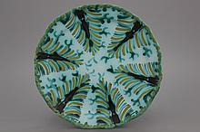 A lobed Brussels faience dish with leaf patterns, 18th C