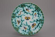 A notched Brussels faience butterfly plate, 18th C.