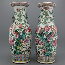 A near pair of Chinese porcelain famille rose vases, 19th C.