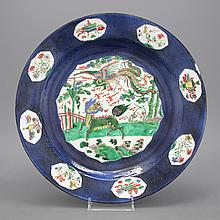 A large powder blue ground famille verte dish, Kangxi, ca. 1690