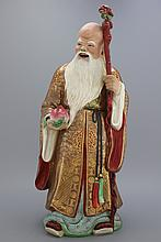 A large Chinese porcelain famille rose immortal figure, Republic