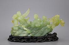 A Chinese carved jadeite group, Cultural Revolution, 20th C.