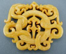 Intricately Carved Yellow Jade Dragon Pendant.
