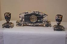 Art Deco Clock and matching pair of Garnitures