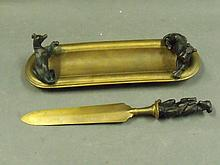 A bronze pin tray and letter opener with greyhound
