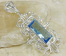 Hand made Sterling Silver & Blue Topaz Pendant