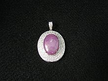 18 Karat White Gold, Star Ruby and Diamond Pendant