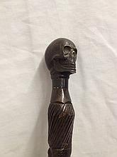 A bronzed skull handled African tribal cane