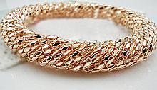 High Fashion Twisted Design Bangle Gold Tone Brace