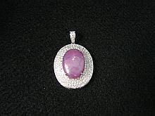 18 Karat White Gold, Star Ruby and Diamond Pendant
