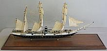 Model of USS Kearsage in a Brass and Glass Case.