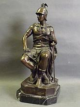 A bronze figure of a seated warrior with sword
