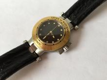 18k yellow gold bezel and stainless steel Date watch ANDRE LE MARQUAND MUSTANG GENEVE with genuine sharkskin strap and original buckle. Black dial