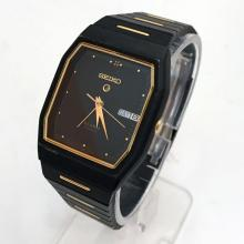 Black and gold color SEIKO Day Date Alarm, Quartz watch with matching bracelet